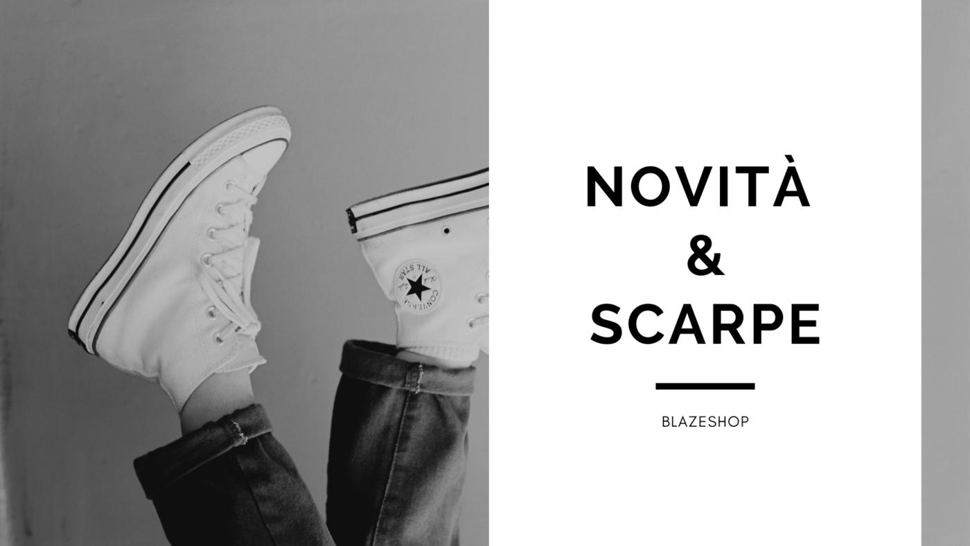 Persona con scarpe converse all stars in bianco e nero con scritto novità e scarpe